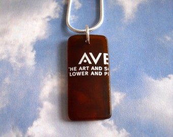 AVEDA Logo AV Recycled Amber Glass Made from a Bottle NAKED Necklace