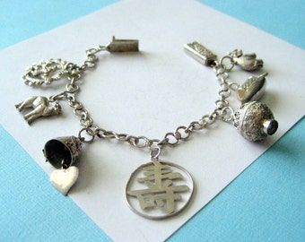 Siam Sterling Silver Charm Bracelet with Thai Charms 1950's