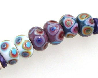 Handmade Lampwork Glass Beads - 3 pairs. Dot reactions on cream, violet, denim blue. Stacked dots, earring pairs, reactive colors.