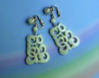 Vintage 60s Exotic Openwork Plastic Clip On Earrings