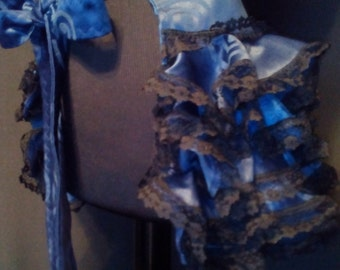 Victorian Style Ruffle Bustle in blue and black lace.