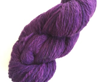 Handspun plyed wool yarn approximately 148 yards solid purple.