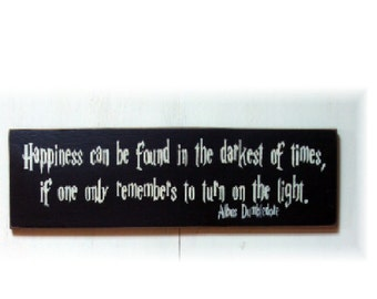 Happiness can be found in the darkest of times if one only remembers to turn on the light wood sign