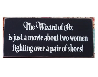 The Wizard of Oz is just a movie about two women fighting over a pair of shoes primitive sign