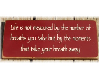 Life is not measured by the number of breaths you take... primitive wood sign