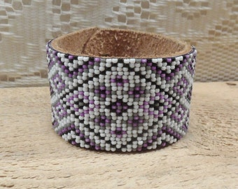 Seed bead bracelet on leather. purple gray white and black colored beads on purple leather
