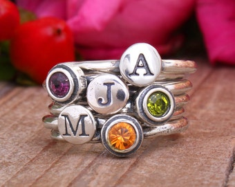 Stacking Birthstone Initial Ring Set of 6 Rings in Sterling Silver by Nelle and Lizzy. Each birthstone and initial represents a child.
