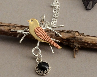 Bird necklace sterling silver mixed metal sparrow pendant black onyx nature jewelry silver tree branch unusual contemporary artisan stone
