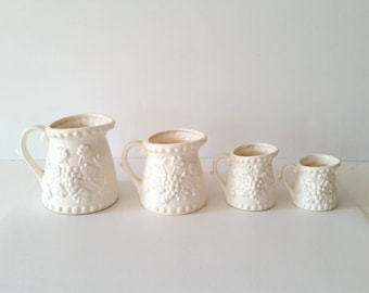 Vintage Enesco Measuring Cups . Set of Four Ceramic Measuring Pitchers . Japan . White Ivory Cream