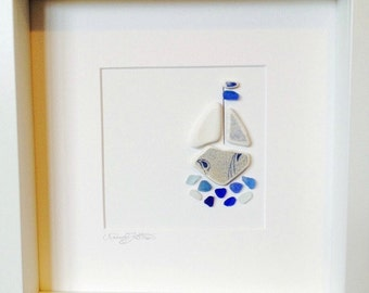 Irish Sea Glass & Sea Pottery Wall Art -Blue Crazed Pottery Boat on a mixed Blue Sea Glass Sea