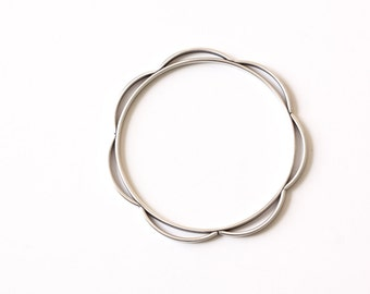 """Sterling silver bangle of a unique 3-D design w/ many curved wire pieces lining the outside of the circle - """"Ceres bracelet"""""""