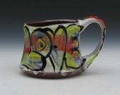 love mug rainbow of colors handmade wheel thrown ergonomic  quality pottery