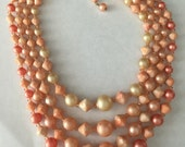 Vintage Hong Kong 4 Strand Coral & Cream Plastic Bead Necklace 1960's
