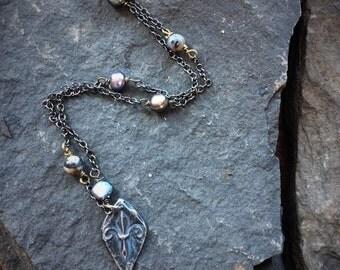 Rustic silver fleur de lis necklace