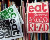 EAT SLEEP READ handprinted linocut card