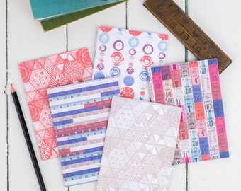 Set of 5 A6 Notebooks, plain paper notepad, multipack unlined sketchbook, tickets, buttons, measures, coral and taupe designs