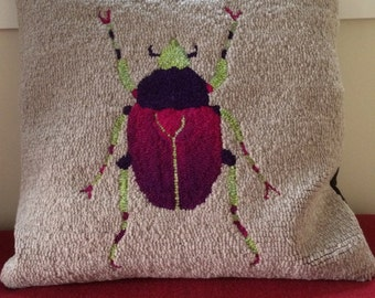 Purple beetle pillow