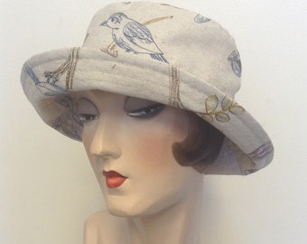 SALE. Embroidered linen fabric sun hat, travel hat, bird, embroidery,