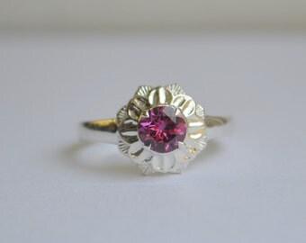 Engraved Camellia Ring in Argentium Silver with Purple Rhodolite Garnet