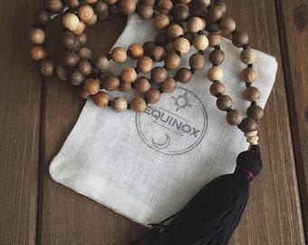 Terra, a Sandalwood mala. Handmade by Equinox Goods.