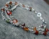 Courtney....Sterling Silver  triple strand Multi- Garnet Gemstone Bracelet