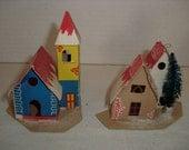 B) Two Small Cardboard Christmas Houses