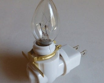 Rotating night light plug - 7 Watt bulb - brass clip