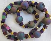 Titanium aura quartz necklace accented with purples, blues and gold
