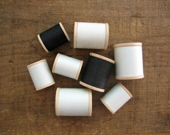 8 Wooden Spools of Unused White and Black Thread