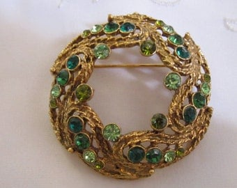 Vintage Gold Tone Brooch with Rope Design and Shades of Green Rhinestones