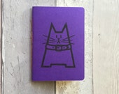 Handmade purple notebook featuring Dave the cat - hand printed, stitched and trimmed A6 cat journal, unlined