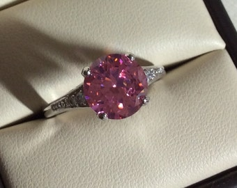 Pink Topaz ring, size 6 and 7 set in solid Sterling silver