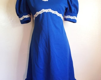 Vintage inspired blue empire waist dress with white embroidery