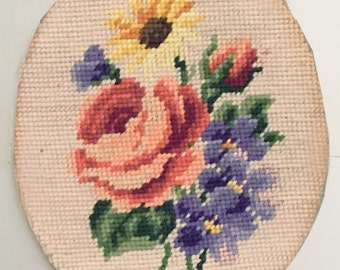 """Vintage Needlepoint Roses, Oval piece - was originally framed. 9"""" tall 7"""" wide"""
