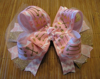 3402 light pink with gold arrows double ribbon boutique bow with tulle and spikes