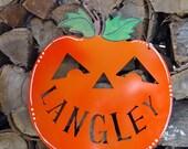 Personalized metal pumpkin door hanger
