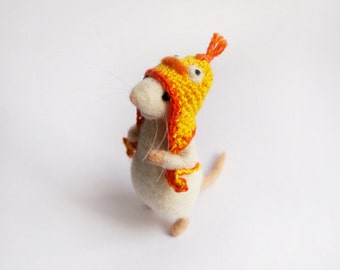 Needle felted mouse wearing crochet duck hat