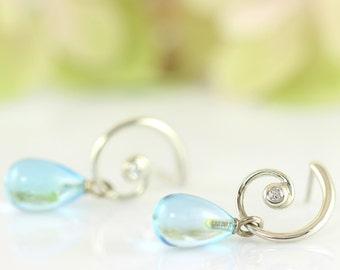 FAUN romantic silver earrings with diamonds