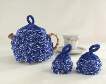 Blue tea cozy with two matching egg cosies