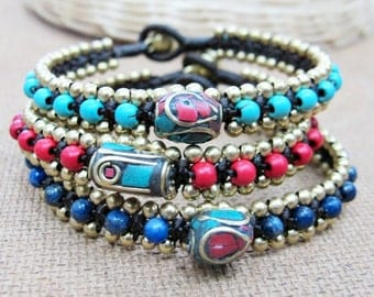 Beaded Bracelet with Ellipse Tibetan Style Brass with Coral and Turquoise in Lapis Lazuli Bead.