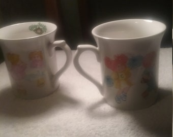 pair of vintage cabbage patch mugs