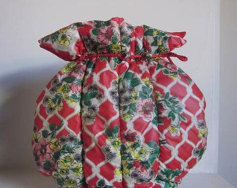 Fun Vintage Floral Tea Cosy. 1950's to 60's. Interesting Design with Wooden Base. Bright Red Plastic Outer with quilting. Lined.