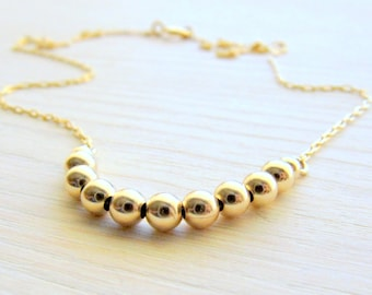 Small gold necklace . Thin gold necklace . Tiny gold Necklace . Gold bead necklace . Gold everyday necklace