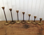 7 Vintage Graduating Brass Candle Sticks