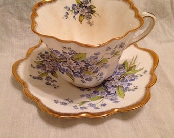 Lovely Vintage Cup and Saucer Forget Me Not Flowers Unique Shape Rosina Bone China Made In England Lovely Delicate  Blue Flowers Gold Trim