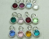 Add a channel set Swarovski birthstone crystal to personalized initial necklace or other MesmericJewelry item