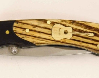 Rough Rider knife with Zebra wood handle and Custom maple guitar inlay
