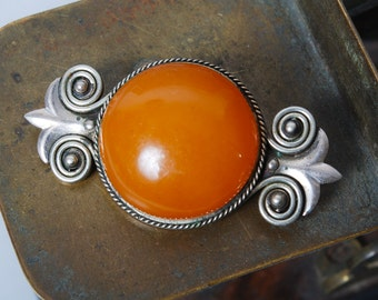Vintage metal brooch with pressed Amber cabochon