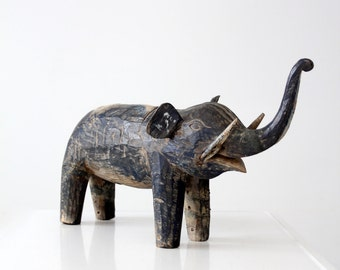 antique carved wood elephant, wooden statue