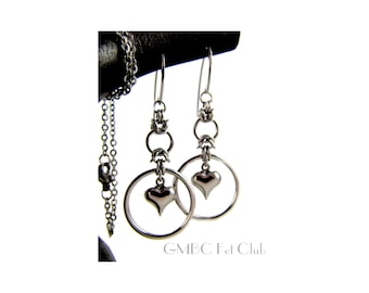 A steel heart captured by a circle of steel -  Stainless Steel Earrings